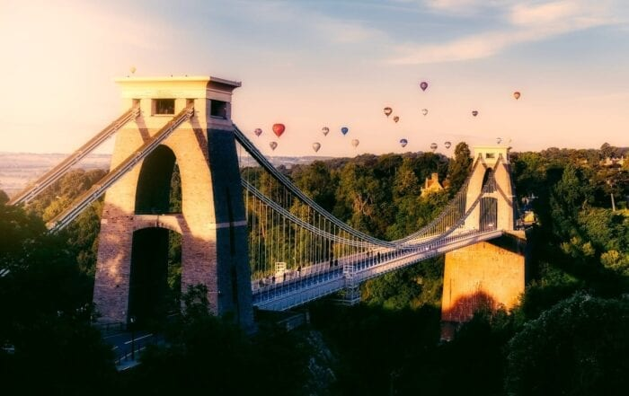 image of a large bridge with hot air balloons in the sky