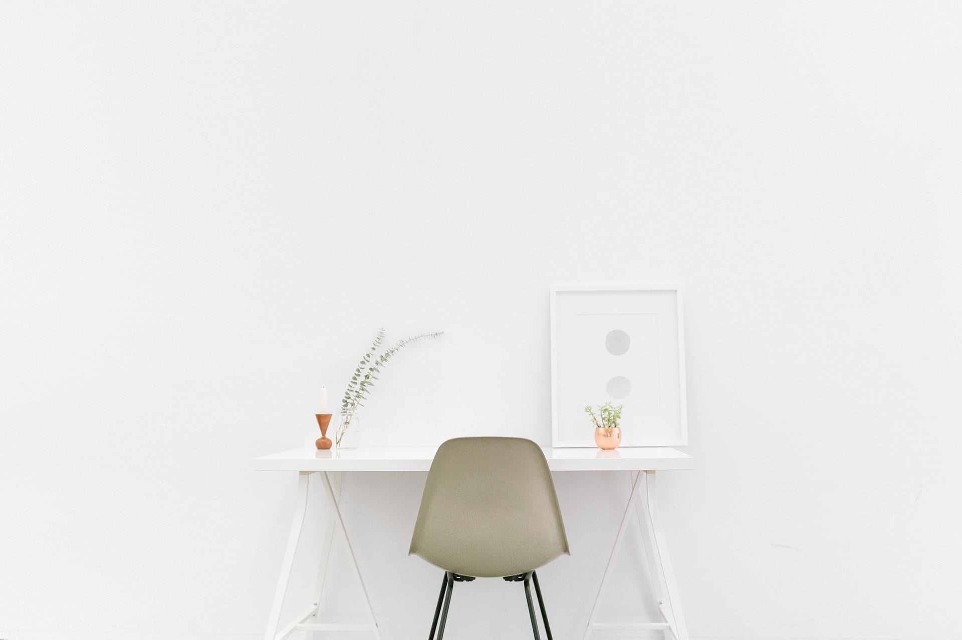 photo of a chair at a white desk