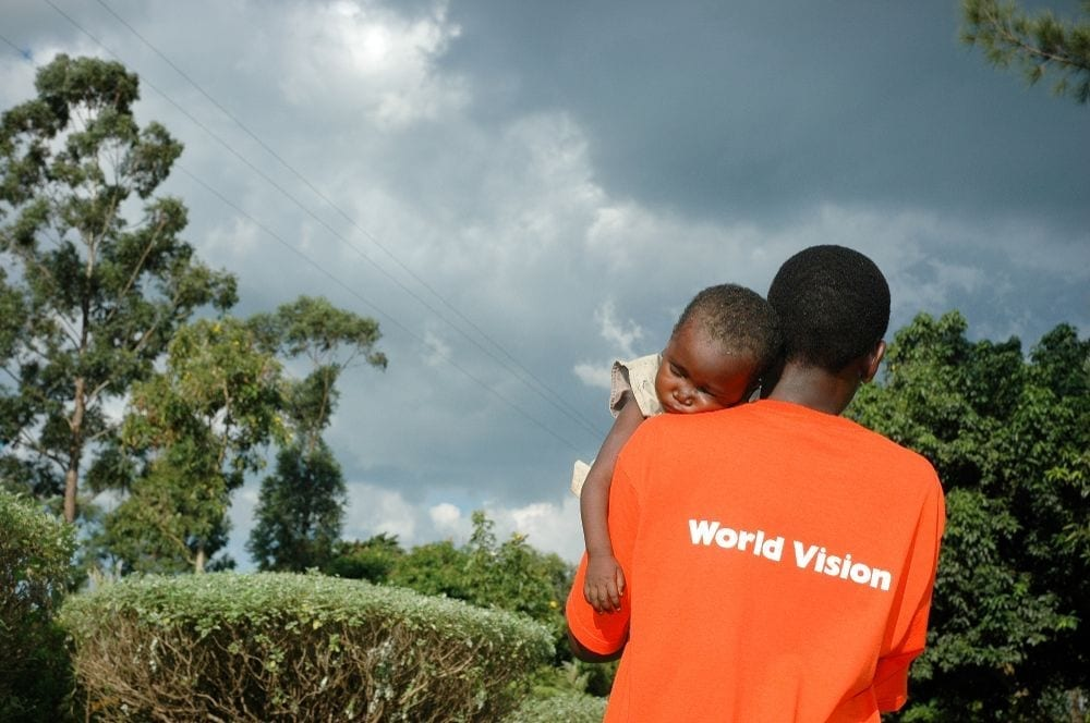 World Vision - Man Carrying Child