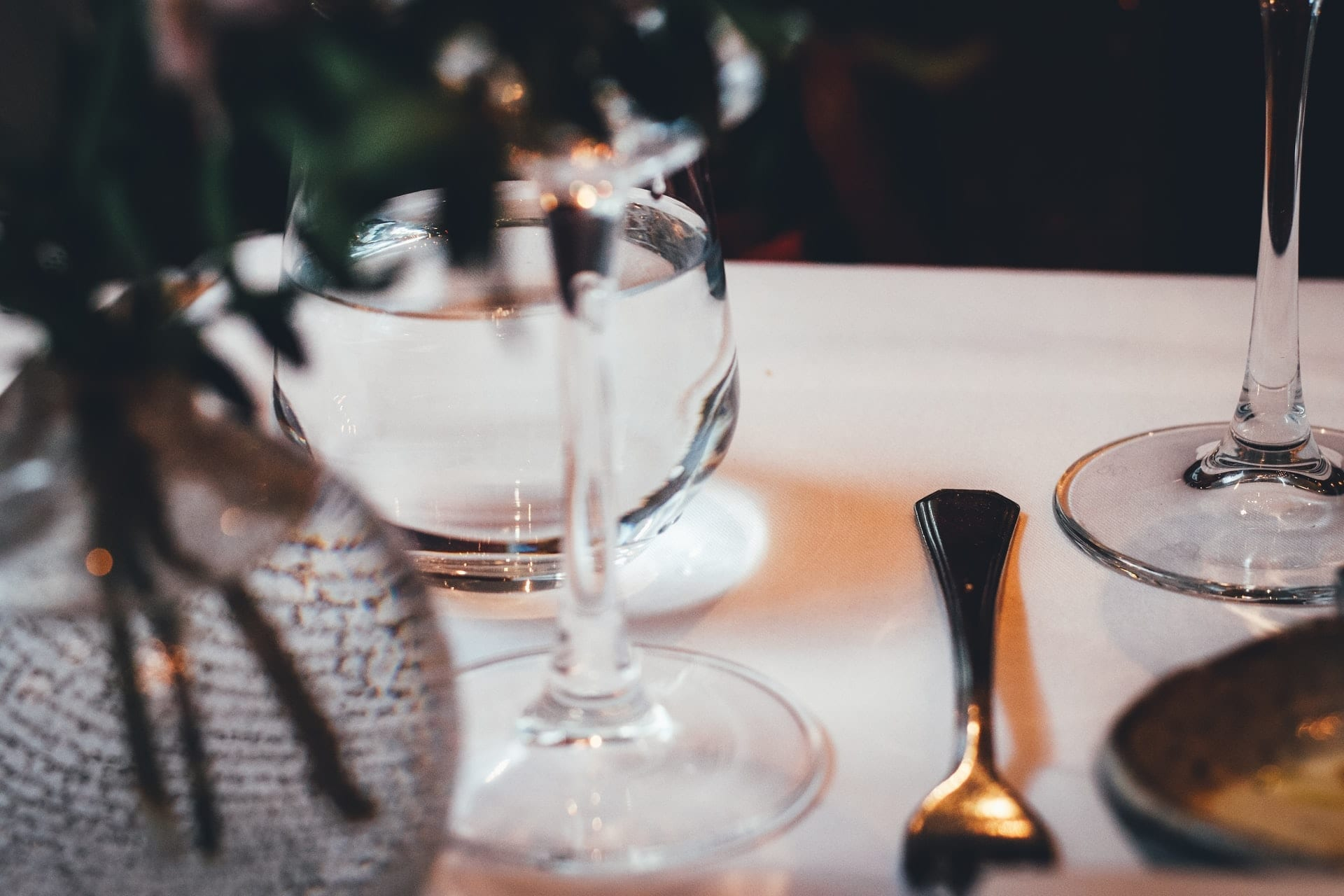 picture of a dining table with cutlery and a glass