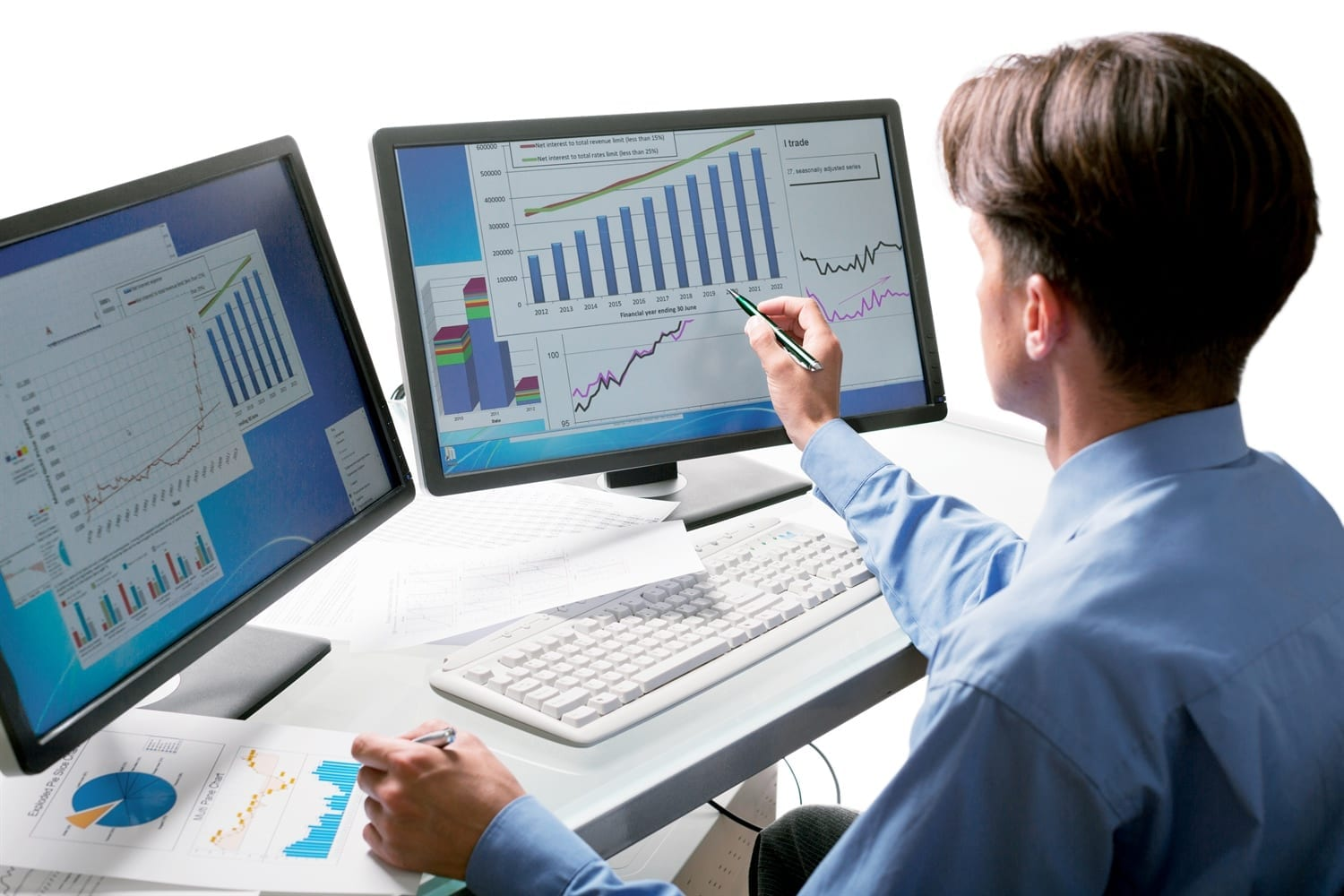 Man sat at desk looking at Legal and Finance details on screen