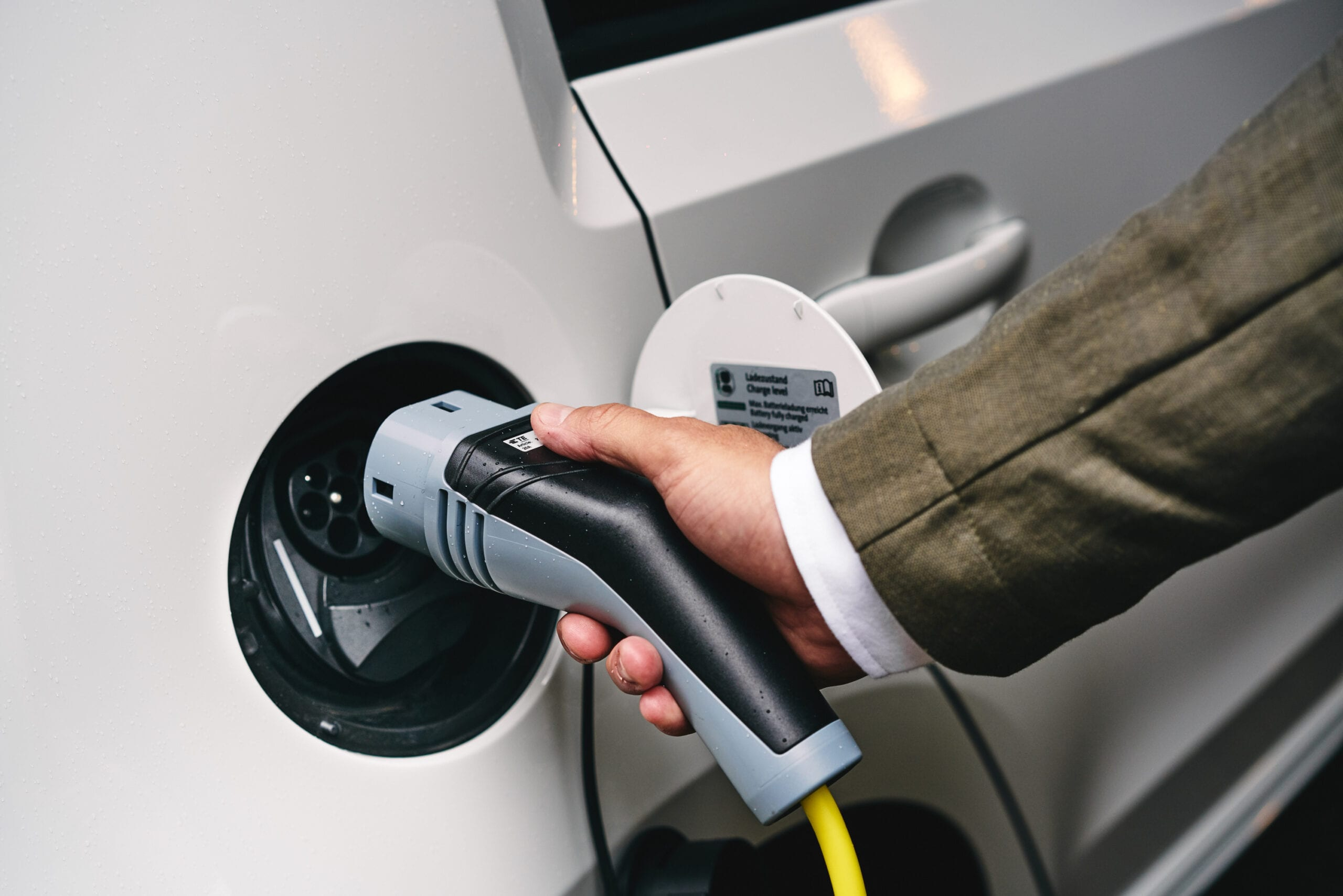 Plugging in charger to an electric vehicle